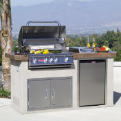 outdoor kitchen island with closed grill in the evening